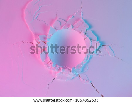 Powder texture with round impact crater. Neon pink and purple violet color lights. #1057862633