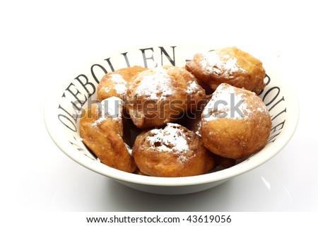 stock-photo-powdered-dutch-oliebollen-in-a-white-bowl-43619056.jpg