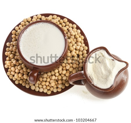 powdered milk drink in a clay cup with soy beans on white background
