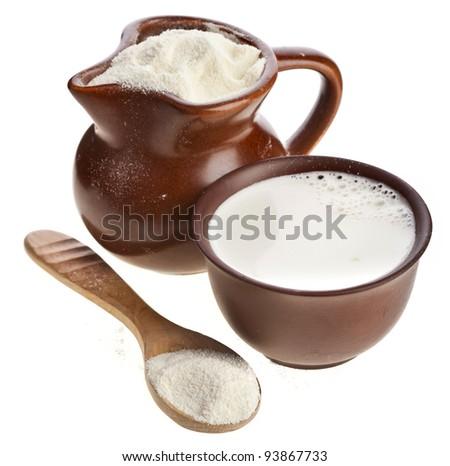 powdered milk drink  in clay  pitcher and cup on white background