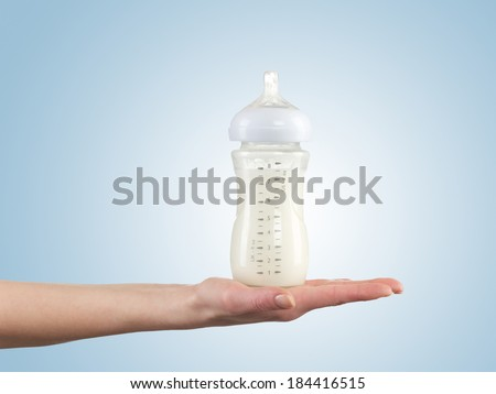 Powdered milk in bottle, dairy food for baby.