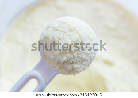 Powdered milk with spoon for baby
