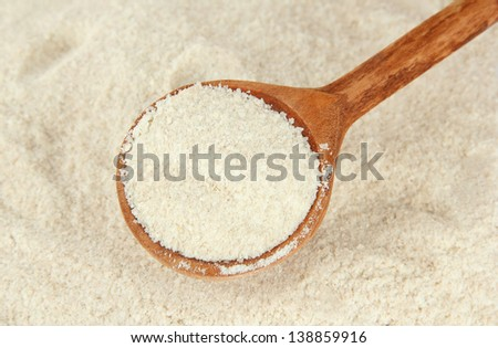Powdered milk with spoon for baby close-up