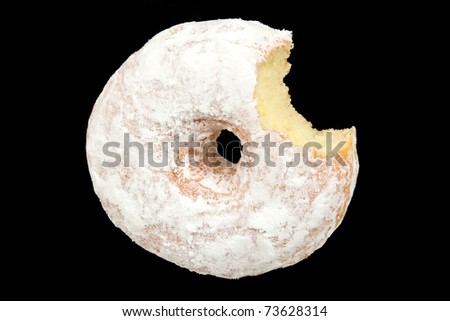 Powdered Sugar Donut with Bite Missing Isolated on Black Background