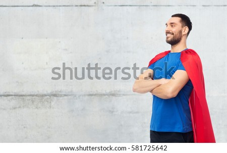 power and people concept - happy man in red superhero cape over gray concrete wall background #581725642