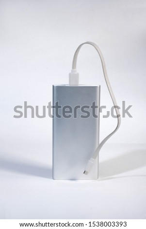 Power bank for charging mobile devices. White smart phone charger with power bank. battery bank. External battery for mobile devices. #1538003393