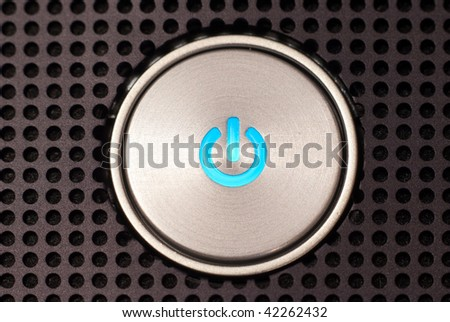power button on dotted surface