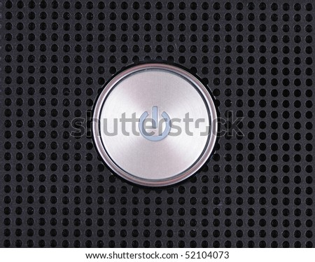 Power button on metal hole background