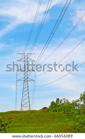Power cable tower on a hill. Concept of power transmission.