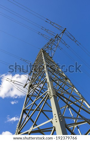 power cable tower on sky with clouds
