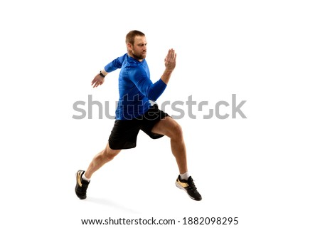 Power. Caucasian professional jogger, runner training isolated on white studio background. Muscular, sportive man, emotional. Concept of action, motion, youth, healthy lifestyle. Copyspace for ad. Photo stock ©
