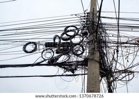 power cord on an electric pole in Thailand.