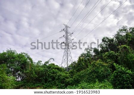 Power distribution pylon system to rural community and countryside , Landscape mountain with green nature, Energy be friendly with environment concept Photo stock ©