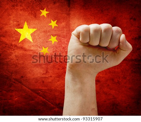 Power fist on grunge flag of China.
