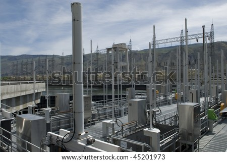 power generating equipment at a large hydro electric dam on a river