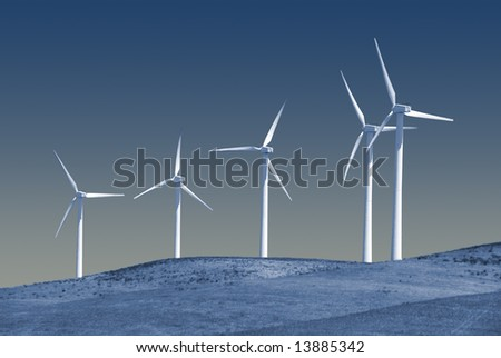 Power generating wind turbines on cattle ranch with rolling hills, Rio Vista California.