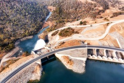 Power generation dam on Snowy River in Snowy mountains of Australia - Lake Jindabyne. Aerial top down view over gate and spillway.