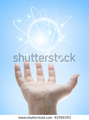 Power in the hands controlling a ball of energy.