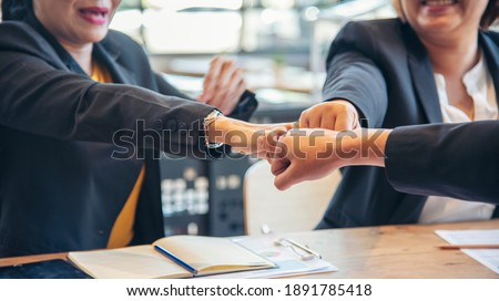 Power leader together Group diversity people fist bump holding hands together power of tag team concept. Power strength multi ethnic people group working togetherness powerful team leadership together