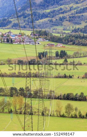 Power line that goes across the fields in tyrol