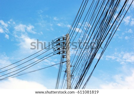 Power lines and electric poles on the sky background. #611081819