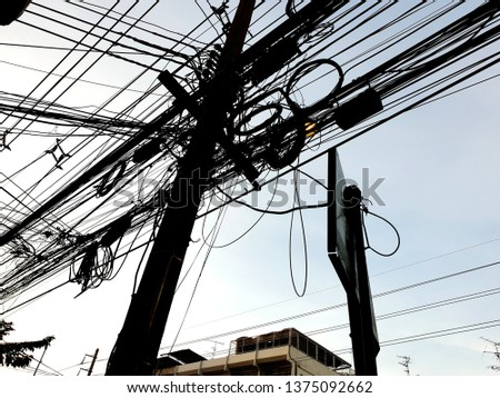 Power lines and telephone lines in Thailand #1375092662
