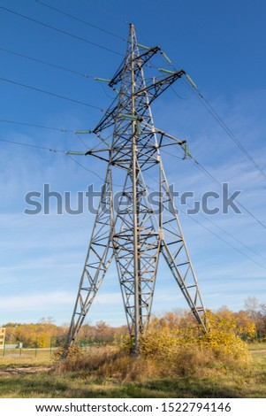Power lines, insulators and wires. high voltage pylons against the blue sky and sunlight. High voltage tower or high voltage tower. Green energy concept, Power plant, Close up of high voltage #1522794146