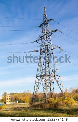 Power lines, insulators and wires. high voltage pylons against the blue sky and sunlight. High voltage tower or high voltage tower. Green energy concept, Power plant, Close up of high voltage #1522794149