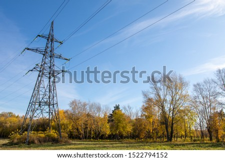 Power lines, insulators and wires. high voltage pylons against the blue sky and sunlight. High voltage tower or high voltage tower. Green energy concept, Power plant, Close up of high voltage #1522794152