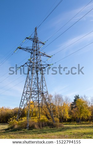 Power lines, insulators and wires. high voltage pylons against the blue sky and sunlight. High voltage tower or high voltage tower. Green energy concept, Power plant, Close up of high voltage #1522794155