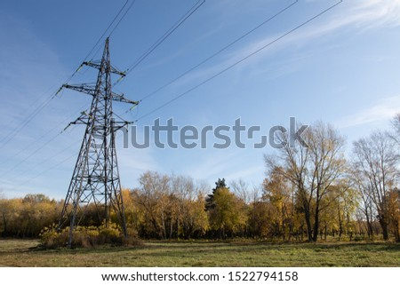 Power lines, insulators and wires. high voltage pylons against the blue sky and sunlight. High voltage tower or high voltage tower. Green energy concept, Power plant, Close up of high voltage #1522794158