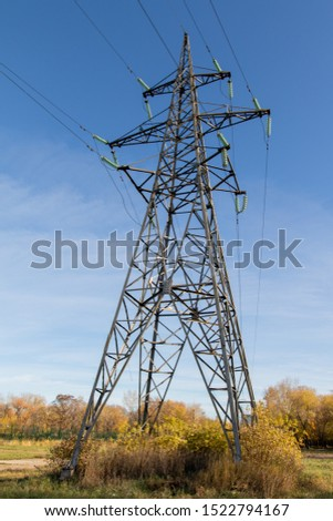 Power lines, insulators and wires. high voltage pylons against the blue sky and sunlight. High voltage tower or high voltage tower. Green energy concept, Power plant, Close up of high voltage #1522794167