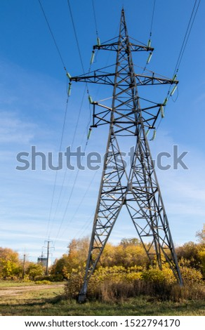 Power lines, insulators and wires. high voltage pylons against the blue sky and sunlight. High voltage tower or high voltage tower. Green energy concept, Power plant, Close up of high voltage #1522794170
