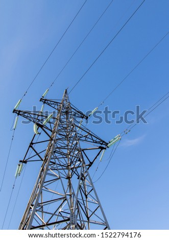 Power lines, insulators and wires. high voltage pylons against the blue sky and sunlight. High voltage tower or high voltage tower. Green energy concept, Power plant, Close up of high voltage #1522794176