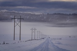 Power Lines Lining Desolate Winter Road in Rural Idaho