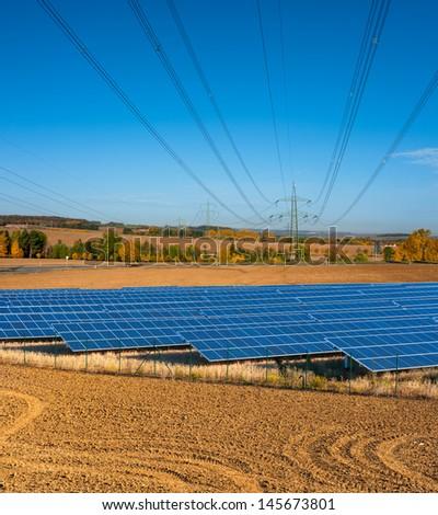 Power lines run above solar power station