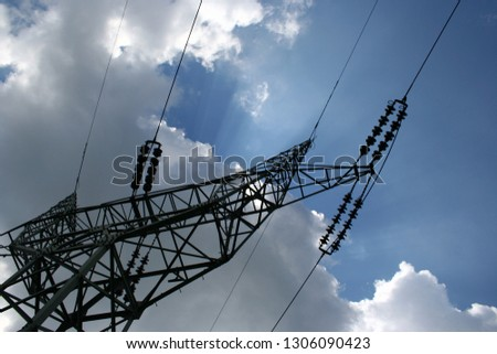 power lines with blue sky and sun rays #1306090423