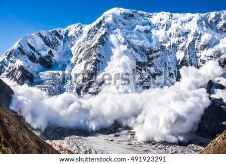 Power of nature. Real huge avalanche comes from a big mountain, Shkhara, 5.193 m, Caucasus, Kabardino-Balkaria, Bezengi region, Russia