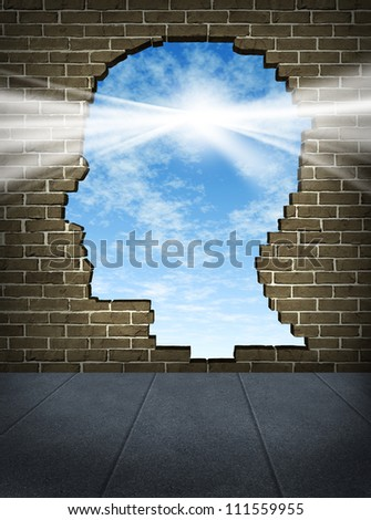 Power of the mind and free your brain mental health symbol of spirituality and freedom of thought with a human head shaped hole on a brick wall in a city street with a glowing sun on a blue sky.