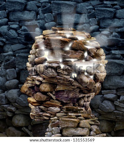 Power of thinking and free your mind as a business or health care concept with a group of rocks in the shape of a human head glowing with a bright inner light as a symbol of freedom and intelligence.