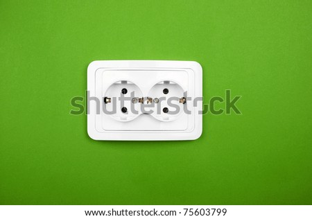 Power outlet on green wall