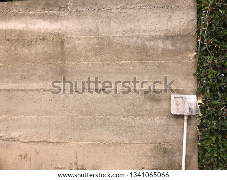 Power Outlet on rough cement wall