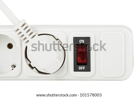 Power outlet with red button on a white background