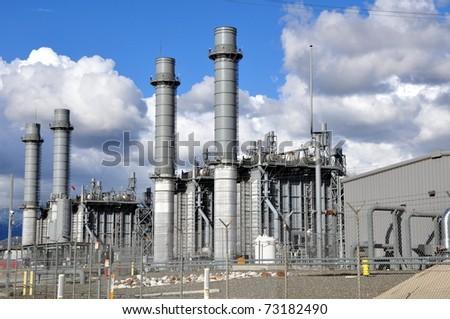 Power plant against cloudy blue sky