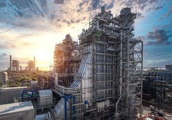 Power plant and steam turbine generator natural gas combined cycle with blue sky, Oil and gas refinery industrial zone on sunset, Gas turbine electrical power plant during construction, Gas turbine
