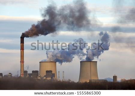 Power plant emitin smoke and steam Сток-фото ©