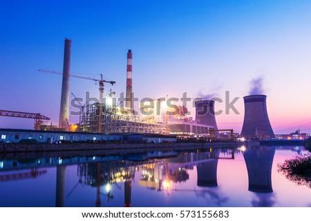 power plant near river at twilight