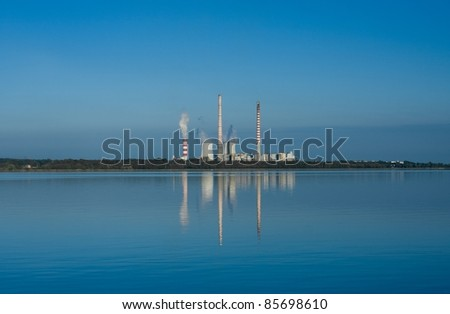 Power plant reflection in a lake