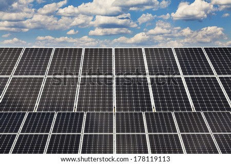 Power plant using renewable solar energy with sun. Selective focus on back panel.