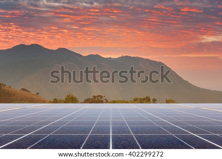 Power plant using renewable solar energy with sunset over the Gap in the Great Smoky Mountains background